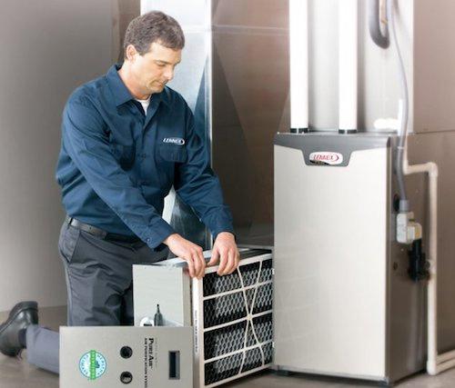 Denver HVAC Technician repairing furnace