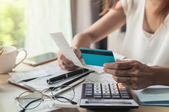 Image of women paying bills