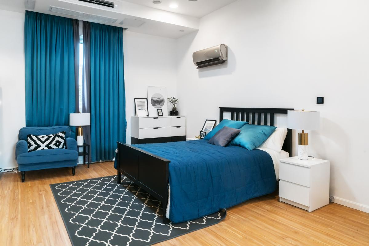 bedroom modern blue decor with wall ac unit