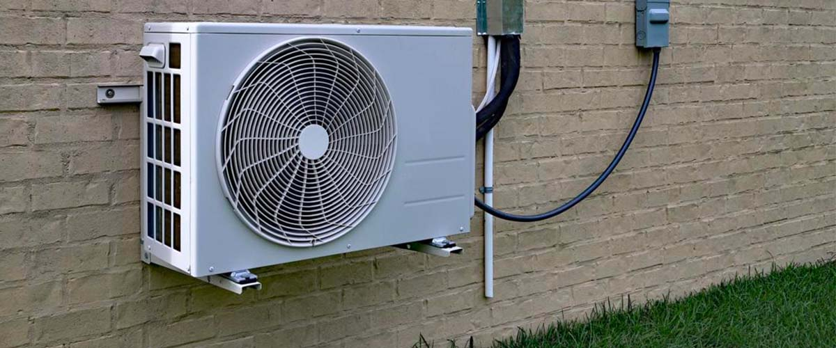 ductless AC unit wall outside denver home