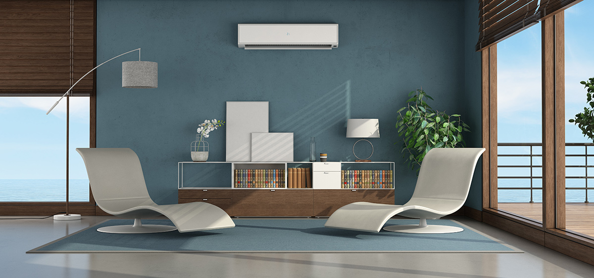 living room house with two chaise lounge and air conditioner blue wall