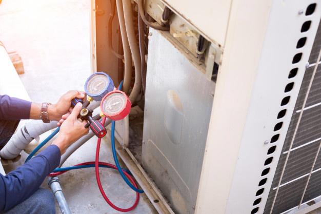 man-checking-furnace pressure.jpg
