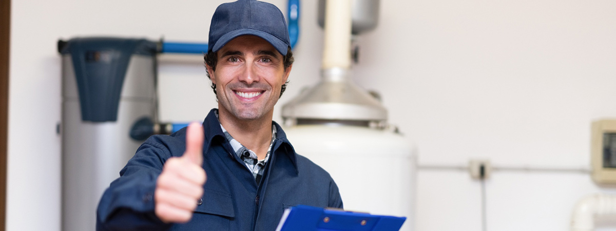 smiling technician servicing hot water heater