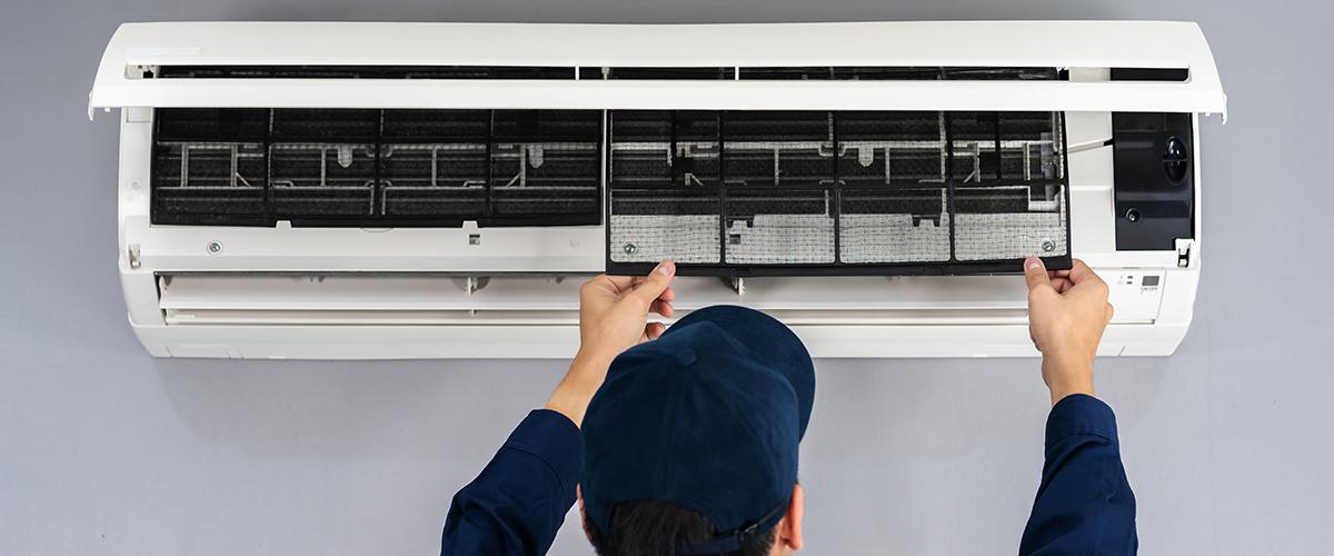 Technician replacing air filter